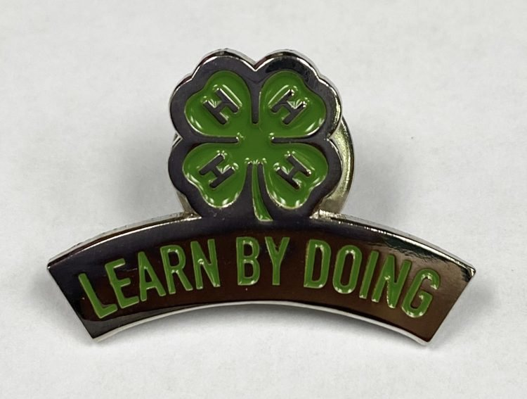 4-H lapel pin - learn by doing and 4-H logo